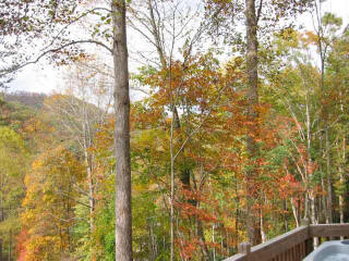 Enjoy the mountain view from the deck and hot tub. NC Rocky Ridge rental cabin. Quiet and secluded, yet just minutes to Nantahala River white water rafting.