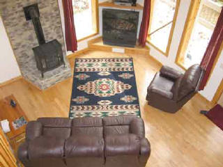 Rocky Ridge rental cabin. Quiet and secluded, yet just minutes to Nantahala River white water rafting NC. Living Room with reclining leather sofa and chair.